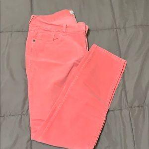 Coral corduroy pants.